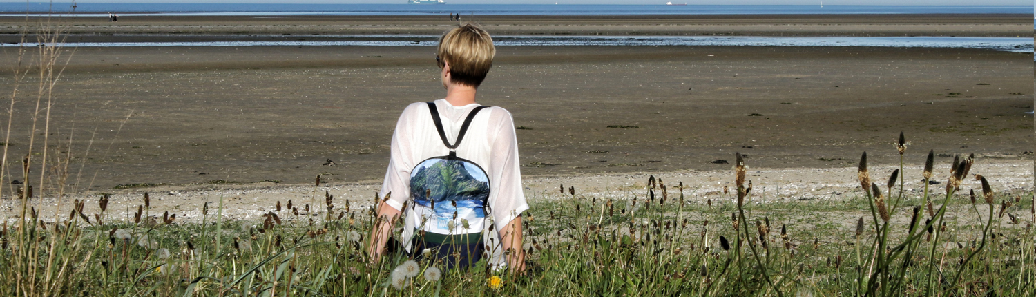 Wild by Water Backpack on the beach